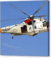A Uh-3h Sea King Helicopter Flies Canvas Print