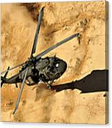 A Uh-60 Black Hawk Helicopter Comes Canvas Print