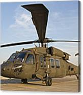A Uh-60 Black Hawk Parked At A Military Canvas Print