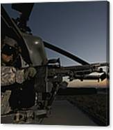 A Uh-60l Blackhawk Door Gunner Mans Canvas Print