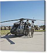 A Uh-60l Blackhawk Parked On Its Pad Canvas Print