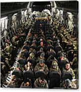 A Unit Of U.s. Army Soldiers In A C-17 Canvas Print