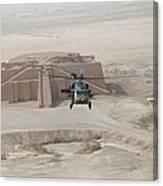A Us Army Black Hawk Helicopter Hovers Canvas Print