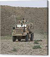 A U.s. Army Cougar Patrols A Wadi Canvas Print