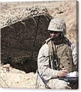 A U.s. Marine Communicates With Close Canvas Print