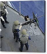 A U.s. Sailor Fires A .50-caliber M2hb Canvas Print