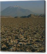 A Volcano Rises Above A Dry Lake Bed Canvas Print