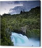A Waterfall Surrounded By A Forested Canvas Print