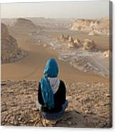 A Woman Sits Quietly On A Cliff Looking Canvas Print
