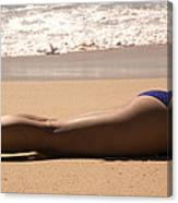 A Woman Sunbathes On The Beach Canvas Print