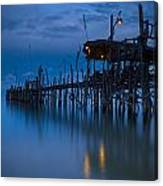 A Wooden Pier With Lights On It At Canvas Print