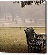 A Wrought Iron Black Metal Bench Under A Tree In The Qutub Minar Compound Canvas Print