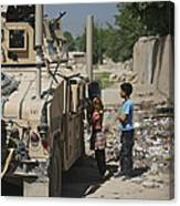 Afghan Children Ask U.s. Soldiers Canvas Print