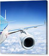 Airliner In Flight Above The Clouds Canvas Print
