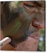Airman Applies War Paint To His Face Canvas Print