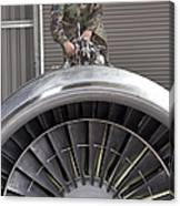 Airman Checks Components Atop A C-5 Canvas Print