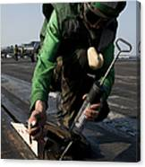 Airman Greases The Catapult Shuttle Canvas Print