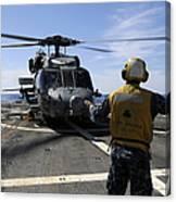 Airman Signals To An Mh-60s Sea Hawk Canvas Print