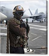 Airman Stands By With Tie-down Chains Canvas Print