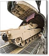 Airmen Load A Tank Into A C-5m Super Canvas Print