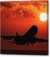 Airplane Landing At Sunset Canvas Print
