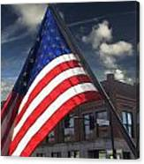 American Flag Flowing In Urban Landscape Canvas Print