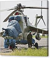 An Afghan Army Soldier Guards A Mi-35 Canvas Print