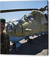 An Afghan Army Soldier Guards An Mi-35 Canvas Print