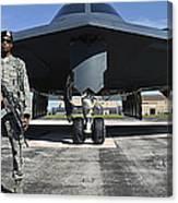 An Airman Guards A B-2 Spirit Canvas Print