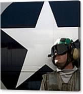 An Airman Stands In Front Of A C-2a Canvas Print