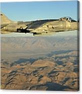 An Av-8b Harrier Conducts A Test Flight Canvas Print