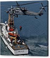 An Hh-60g Pave Hawk Performs A Hoist Canvas Print