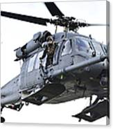 An Hh-60g Pavehawk Helicopter In Flight Canvas Print