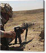 An Iraqi Army Soldier Prepares To Fire Canvas Print