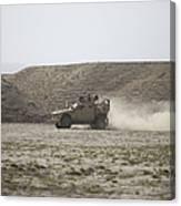 An M-atv Races Across The Wadi Canvas Print