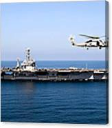 An Mh-60r Sea Hawk Flies Canvas Print