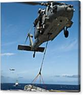 An Mh-60s Sea Hawk Helicopter Lowers Canvas Print