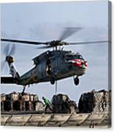 An Mh-60s Sea Hawk Lifts Cargo Canvas Print