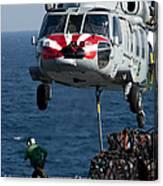 An Mh-60s Sea Hawk Picks Up Pallets Canvas Print