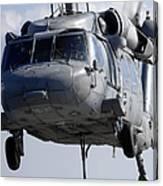 An Mh-60s Seahawk Delivers A Pallet Canvas Print