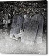 An Old Cemetery With Grave Stones And Fog Canvas Print