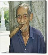 An Old Man Smokes An Over-sized Cigar Canvas Print
