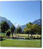 An Open Field In Interlaken With A View Of The Mountains In The Background Canvas Print