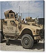 An Oshkosh M-atv Parked At A Military Canvas Print