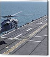 An Sh-60 Sea Hawk Helicopter Lands Canvas Print