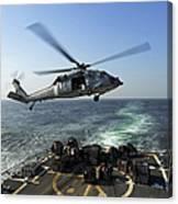 An Sh-60r Sea Hawk Delivers Pallets Canvas Print