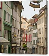 Antique Shop Sign On A Shopping Street Canvas Print