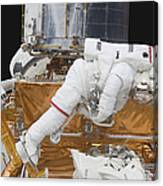 Astronaut Working On The Hubble Space Canvas Print