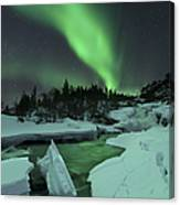 Aurora Borealis Over A Frozen Tennevik Canvas Print
