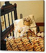 Baby Doll In Crib Canvas Print